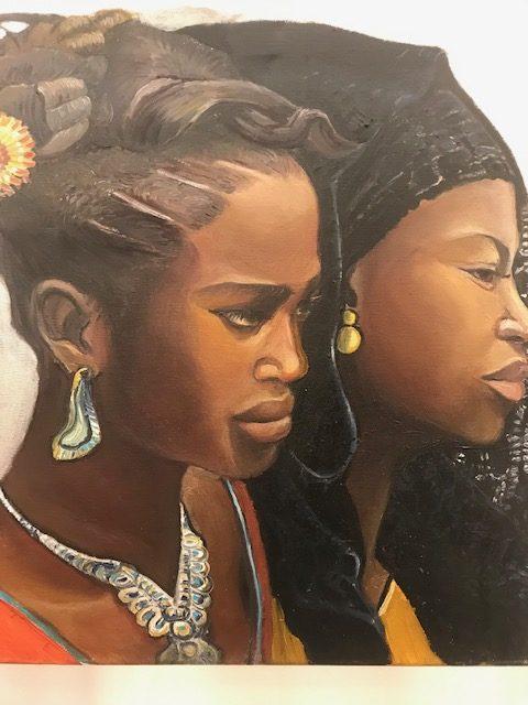 Artysta malarz rzuca okiem na 2 Afrykanki